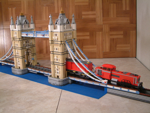 Lego london bridge 10214 designed to let cars and trains pass through.